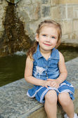 Portrait of smiling little girl in dress outdoor — Stock Photo