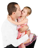Father kissing little girl — Stok fotoğraf