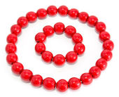 Red wooden beads and bracelet — Stock Photo