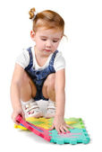 Portrait of little girl playing with construction blocks — Stock Photo