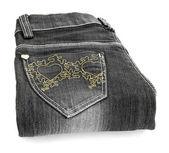 Um par de jeans cinza com um branco — Fotografia Stock