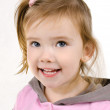 Portrait of cute smiling little girl — Stock Photo #9767072