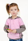 Portrait of cute little girl with a pencils — Stock fotografie