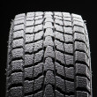 Stock Photo: One winter tire tread full of snow