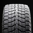 One winter tire tread full of snow — Stock Photo