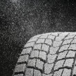Stock Photo: Studio close-up detail of winter tire tread full of snow