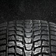 Royalty-Free Stock Photo: Studio close up of wet winter tire tread in the rain