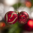 Hanging red and gold christmas tree globes — Stock Photo
