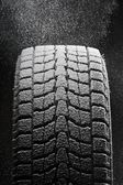 One snowed winter tire tread — Stock Photo