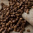 Coffee beans on the sacking - 图库照片