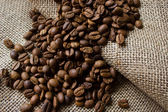 Coffee beans on the sacking — Stock Photo