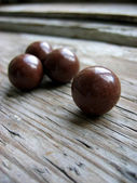 Chocolate balls on an old retro window sill — Stock Photo
