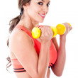Atheltic woman holding weights — Stock Photo