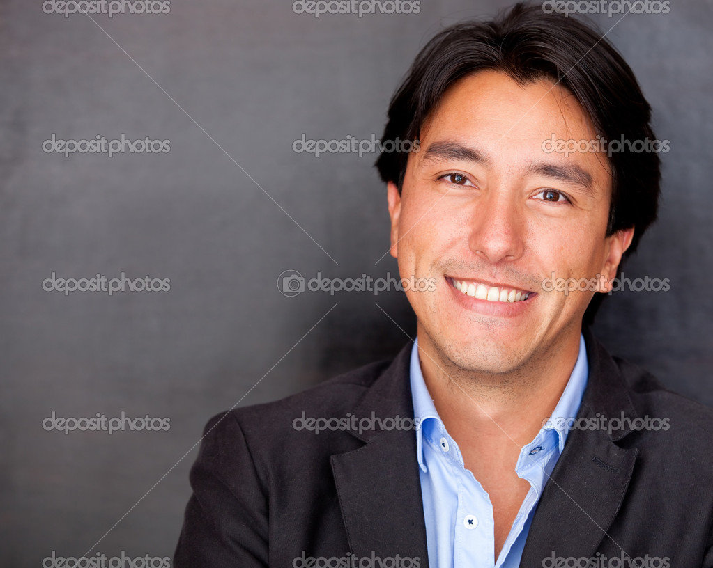 Handsome business man looking happy and smiling — Stock Photo #10027654