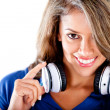 Woman holding headphones — Stock Photo