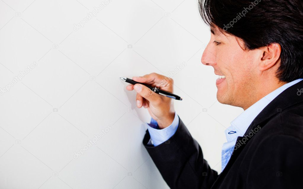 Business man holding a pen and writing - isolated over white — Stock Photo #10052836