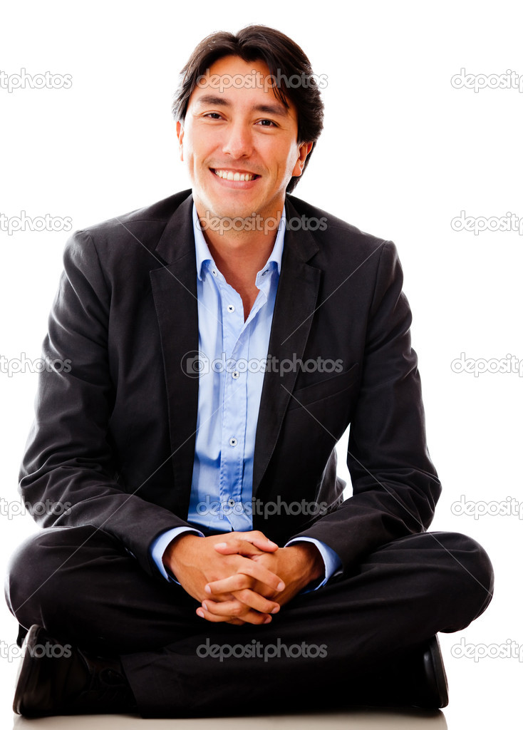 Casual businessman sitting on the floor - isolated over a white background — Stock Photo #10052838