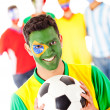 Brazilian football fan with a group - Stock Photo