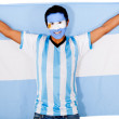 Argentinean man holding flag - Stock Photo