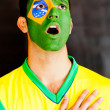 Brazilian man singing anthem - Stock Photo