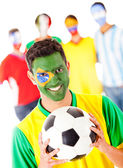 Brazilian football fan with a group — Stock Photo