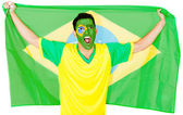Brazilian man celebrating — Stock Photo