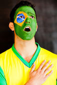 Brazilian man singing anthem — Stock Photo