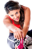 Fit woman stretching — Stockfoto