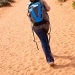 Woman walking the desert — Stock Photo #10147141