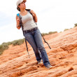 Woman exploring the desert - Stock Photo