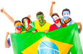 Latin group with Brazilian flag — Stock Photo