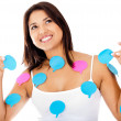 Woman with thought bubbles — Stockfoto