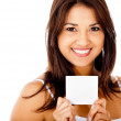 Woman holding a white card — Stock Photo