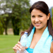 Girl with a bottle of water — Stock Photo