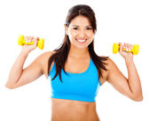 Athetic woman with weights — Stock Photo