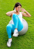 Woman doing Pilates outdoors — Stock Photo