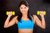 Athletic woman with weights — Stock Photo