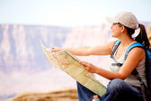 Female tourist with a map — Stock Photo