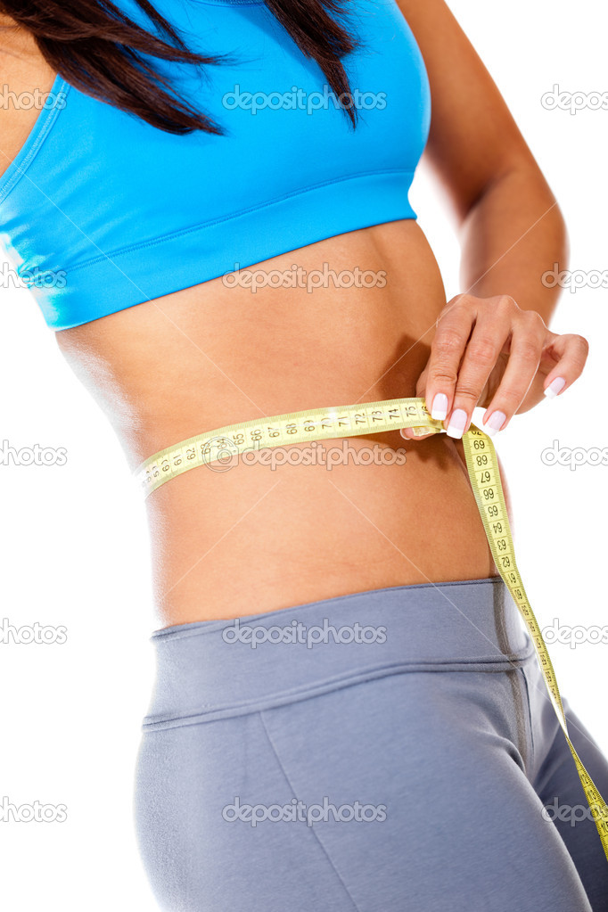 Woman taking measurements with a tape - weight loss concepts — Stock Photo #10224086