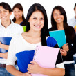 Female student with a group — Stock Photo