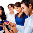 Stock Photo: Friends text messaging