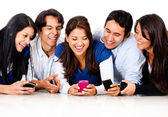 Friends gossiping on a cell phone — Stock Photo