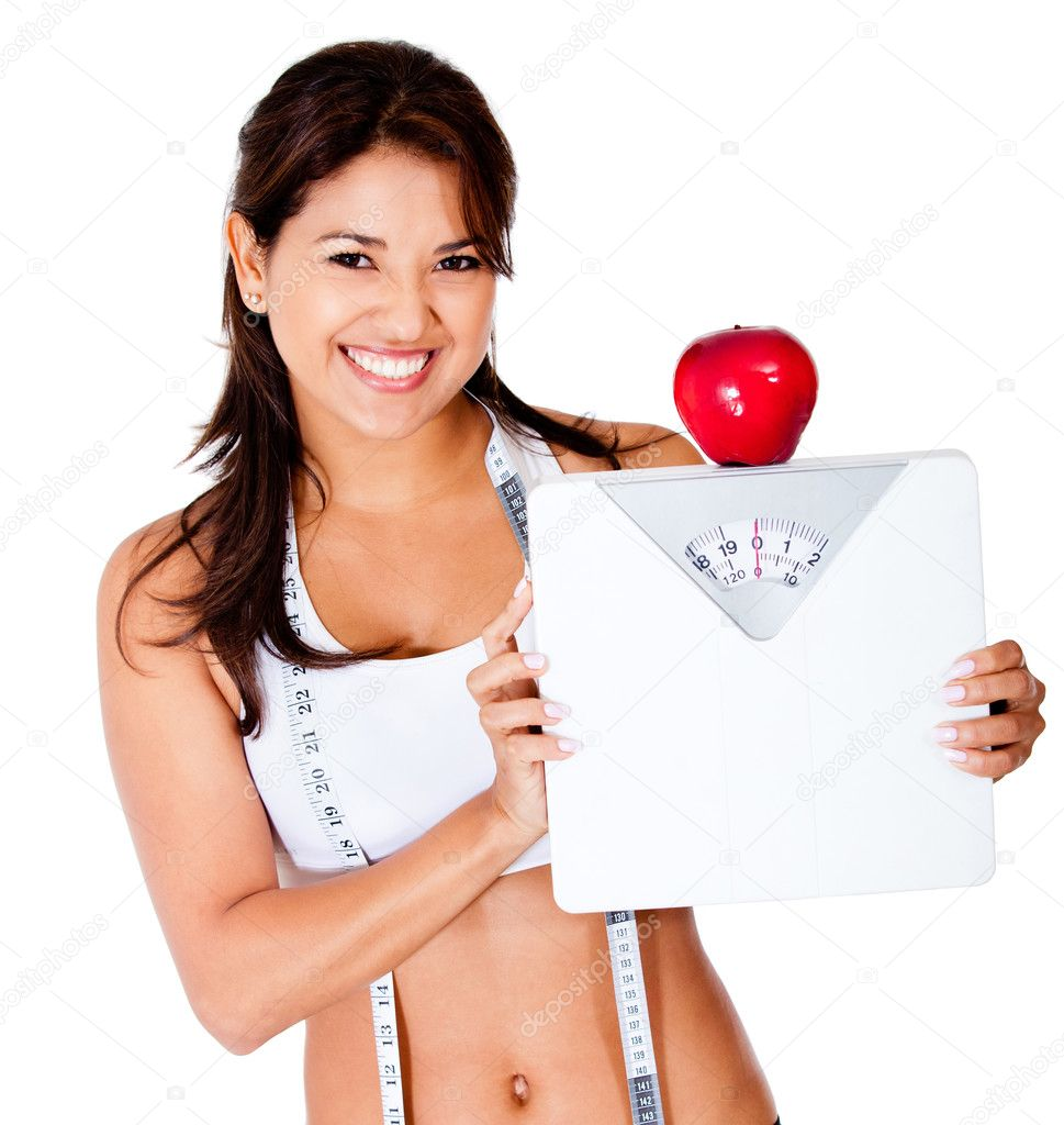 Healthy eating woman on a diet holding a scale - isolated over a white background — Stock Photo #10375288