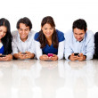 Stock Photo: Texting on their phones