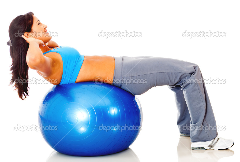 Athletic woman exercising with a Swiss ball - isolated over white — Stock Photo #10394281