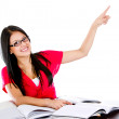 Female student pointing - Stock Photo