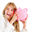 Business woman shaking a piggybank — Stock Photo #10445498