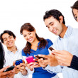 Texting on their cell phones — Stock Photo