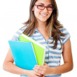 Photo: Female student with notebooks