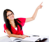 Female student pointing — Stock Photo